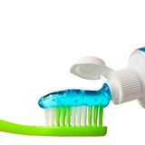 Toothpaste. Putting toothpaste on a brush Royalty Free Stock Photography