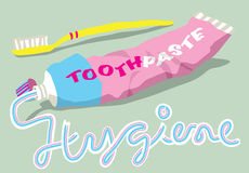 Toothpaste and brush with hygiene word. The word HYGIENE written in toothpaste from a tube and toothbrush Stock Photo