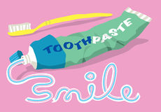 Toothpaste and brush with smile word. The word SMILE written in toothpaste from a tube and toothbrush Royalty Free Stock Photos