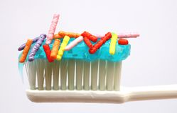 Toothpaste  with candy Royalty Free Stock Image