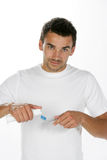Toothpaste. Man putting toothpaste on her toothbrush Stock Photos