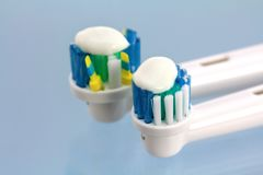 Toothpaste and a new electronic toothbrush head Royalty Free Stock Photo