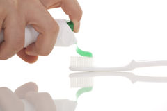 toothpaste onto toothbrush Royalty Free Stock Images