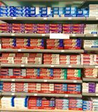 Toothpaste for sale in supermarket. Leading toothpaste brands for sale on supermarket shelves Royalty Free Stock Photo