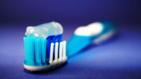 Toothpaste on toothbrush Stock Photo