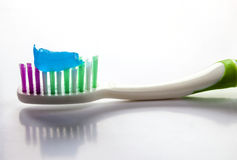 Toothpaste on a toothbrush close-up on a white light background Stock Photos