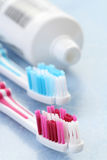 Toothpaste and toothbrushes Royalty Free Stock Image
