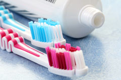 Toothpaste and toothbrushes Stock Image
