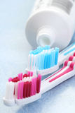 Toothpaste and toothbrushes Stock Photography