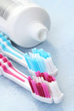 Toothpaste and toothbrushes Stock Photo