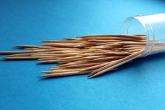 Wooden sharp toothpicks scattered on the table stock images