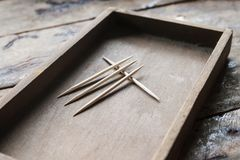 Toothpick. Bamboo Toothpick on the wooden plate. Toothpick is make for clean between the Teeth stock images