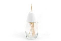 Toothpick bottle. A photo of a glass bottle full of toothpicks over a white background Stock Photos