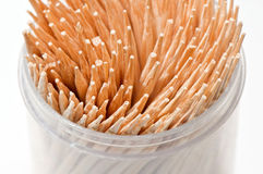 Toothpick in the cylinder. A toothpick inserted in the barrel color white background Royalty Free Stock Images