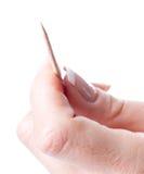 Toothpick a disposizione immagine stock