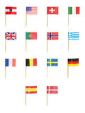 Toothpick Flags. Of various countries isolated over white background stock images