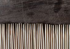 Toothpick lined on an old wood table stock images