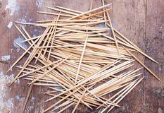 Toothpick. Texture on a wooden background stock image