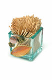 Toothpicks. Small glass elegant vase with wooden toothpicks stock photo