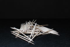 Toothpicks. In a black background Stock Photography