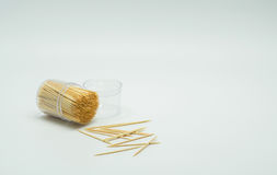 Toothpicks in a clear plastic bottle. And some fell on the floor,Toothpick slant. Toothpick splatter royalty free stock photography