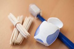 Toothpicks, dental floss and toothbrush Royalty Free Stock Photo