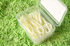 Toothpicks. On green fabric background Royalty Free Stock Image