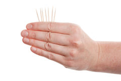 Toothpicks in hand Royalty Free Stock Photography