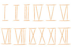 Toothpicks isolated on white. and Old roman antique alphabet num Royalty Free Stock Photos