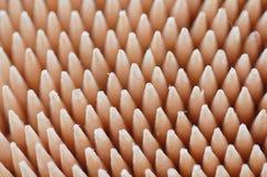 Toothpicks nella priorità bassa bianca fotografia stock