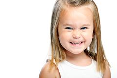 Toothy grin. Cute little girl wearing tank top smiles for her portrait Stock Images