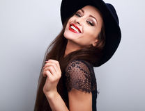 Toothy laughing woman in fashion black hat with bright makeup an Royalty Free Stock Photography