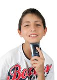 Toothy Lächeln des Jungen und rasierenkinn mit Rasierapparat Stockfotos