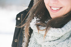 Toothy smile. Brunette girl smiling, snow on her hair Royalty Free Stock Photography