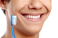 Toothy smile with brush closeup Stock Photography