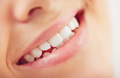 Toothy smile. Close-up of female smile with white teeth Royalty Free Stock Images