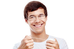 Toothy smile with dental floss Stock Photos