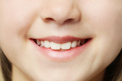 Toothy smile - lips and teeth. Macro Stock Photography
