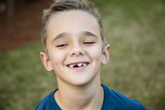 Toothy Smile. Portrait of a young boy showing off his toothy smile Royalty Free Stock Images