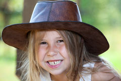 Toothy smile of young pretty girl in cowboy hat, facial portrait. Caucasian Royalty Free Stock Photography