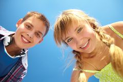 Toothy smiles. Close-up portrait of smiling teenagers looking at the camera Stock Images