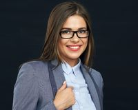 Toothy smiling business woman portrait. Toothy smiling business woman portrait wering glasses. Young model wuth long hair. Blacj background. Studio isolated Stock Images