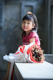 Toothy smiling face of asian kid happiness emotion and dry flowe Stock Photography