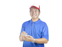 Toothy smiling face of delivery man and smart computer in hand p. Reparing for taking customer order isolated white background Stock Photography