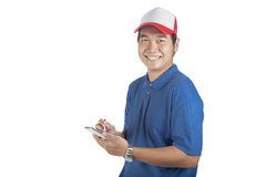Toothy smiling face of delivery man and smart computer in hand p. Reparing for taking customer order isolated whtie background Stock Photo