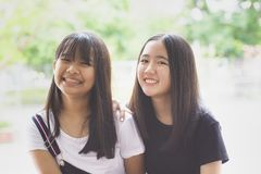 Toothy smiling face happiness emotion of two asian teenager stock photography