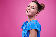 Toothy smiling girl over pink background Royalty Free Stock Image