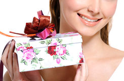 Toothy smiling half female face with present box Royalty Free Stock Photography
