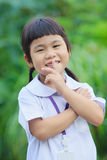 Toothy smiling happiness face of asian children against green bl Stock Photography
