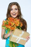 Toothy smiling happy woman holding flower with gift box. White background isolated portrait Royalty Free Stock Images